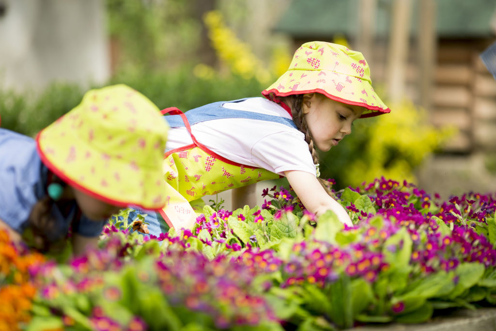 girls in hats in garden