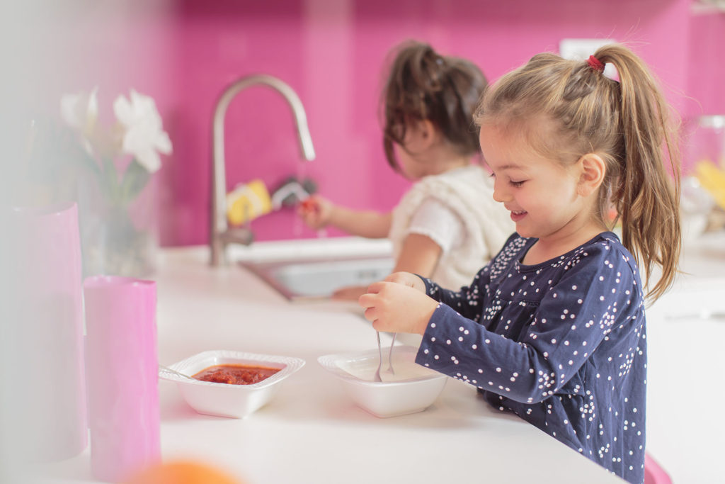 girls with food in kitchen