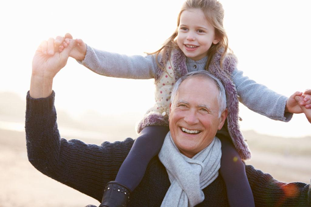 older man with girl on shoulders