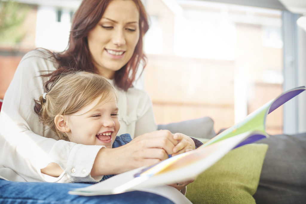 woman reading story to girl